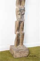 Tall figural totem pole