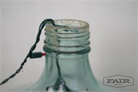 Green wine jug with fairy lights