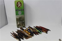 Collection of straight pens and tin container