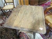 ANTIQUE CLAW FOOTED CARVED SIDE TABLE