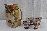Noritake handled pitcher and 4 oriental egg cups