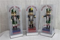 "3 wooden motion musical nutcrackers 11""H"