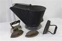 Sad irons and a coal scuttle