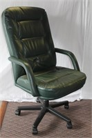 Leather swivel high back arm chair, some wear see
