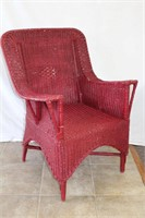 Painted wicker arm chair