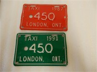 GROUPING OF 2  ALUMINUM TAXI LICENSE PLATES