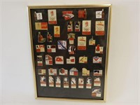 FRAMED LOT OF COCA-COLA OLYMPIC COLLECTOR PINS