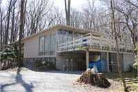 This beautiful mid-century home is for sale!