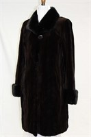 Brown sheared Mink with mink trim cuffs and collar