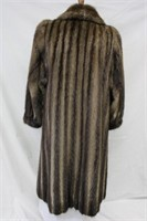 Used Let Out Muskrat coat size M Retail $800.00