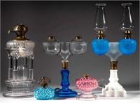 Selection of kerosene lighting including Adams Temple and Ripley Wedding lamps.