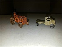 Antique cast iron toy tractor and Tootsie toy