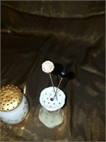 Two antique hat pin holders with hat pins