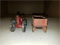 Antique arcade cast iron toy tractor and wagon