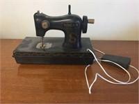 Plastic singer sewing machine.