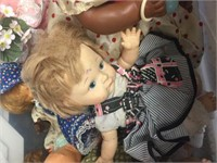 Storage tote of assorted dolls