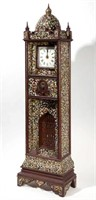 American folk art tall-case clock (c. 1920) exhibiting mosaic decoration and fitted with a Crosley radio, reportedly from an old lodge in the Pittsburgh, PA area
