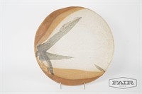 Large clay pottery dish with abstract design