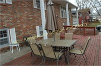 Patio Table, Umbrella, 6 Chairs, Tables, Planters.