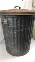 Vintage galvanized metal garbage can with lid