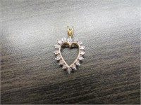 10K GOLD PENDANT WITH DIAMONDS AROUND HEART