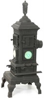 Cast Iron Parlor Stove with Tile Inserts