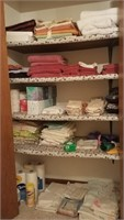 Contents of hall closet, linens, paper products,