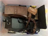 Vintage camera items and luggage cart