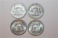 Four Franklin Half Dollars