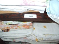 GROUPING OF BEDDING IN THE 1ST BEDROOM CLOSET