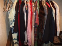 CLOSET FULL OF CLOTHING, LINENS, SUITCASES, AND