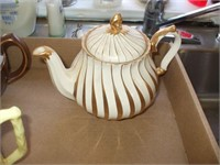 TEAPOTS AND CREAMERS