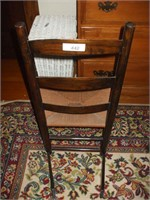 BLACK ROCKING CHAIR W/ PAINTING ON IT