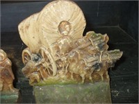 PAIR OF CAST METAL BOOKENDS, NON-MATCHING