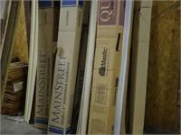 Large Assortment of Unused Vinyl Siding Along