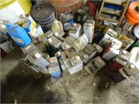 Cans of Refinisher Turpentine, Paint Remover, and