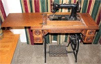 Old Treadle Sewing Machine in Cabinet (view 2)