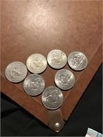 Seven 1972 Ike dollars