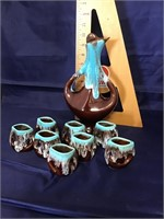 Stylized pottery decanter eight cups