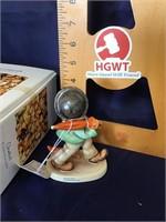 Hummel figurine strolling along