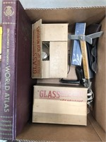 Box with glass cups/world atlas/glasses