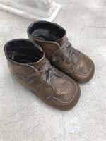 Pair of metal baby shoes