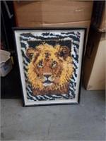 Framed lion tapestry