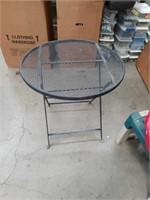 Round metal patio table