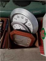 Box of wall clocks