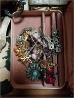 Box of jewelry, antique camera