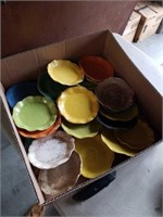 Box of pottery saucers