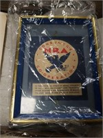 Box of old signs and plaques