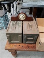 Box of ammo boxes and electric mantel clock