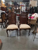 Pair of cain back arm chairs